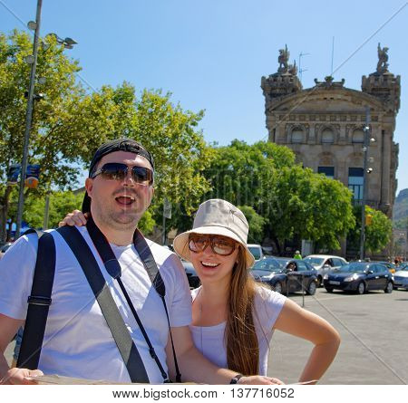 Tourists And A City Map In La Rambla Street