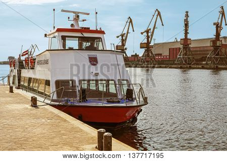 Ventspils Latvia - May 8 2016: Excursion Ferry docked on the Venta River in Ventspils Latvia. Ventspils a city in the Courland region of Latvia. Latvia is one of the Baltic countries