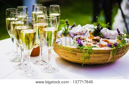champagne glass with canape outside in garden party