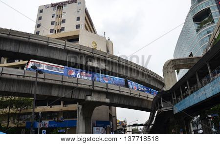 BANGKOK THAILAND- 05 JULY 2016: BTS sky train in front of Siam Discovery Rama I Rd Skywalk. Bangkok Thailand. Siam Discovery is one of Bangkok's main shopping areas.