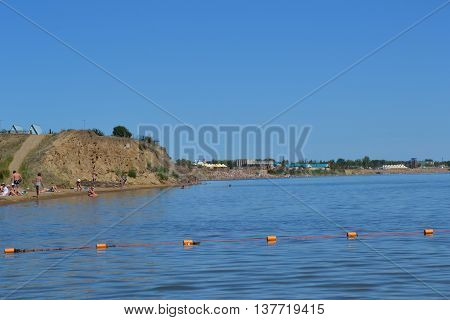 Buoys on the salt lake on the background of a distant beach