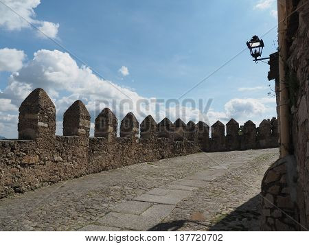 Historic road with crenellations in the old town of Trujillo, Spain
