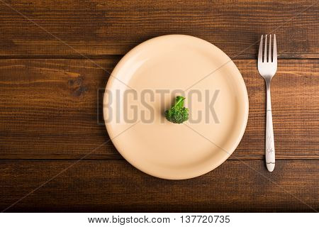 Broccoli With White Plate, Fork On Wooden Rustic Background, Diet Concept With Broccoli. Top View
