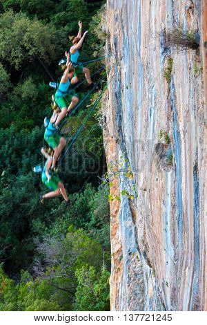 Female Climber falling down from Top of high colorful rocky Wall combined series of shoots in different positions of athlete