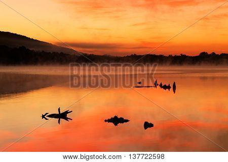 A misty sunrise at Locust Lake State Park Schuylkill County Pennsylvania USA.
