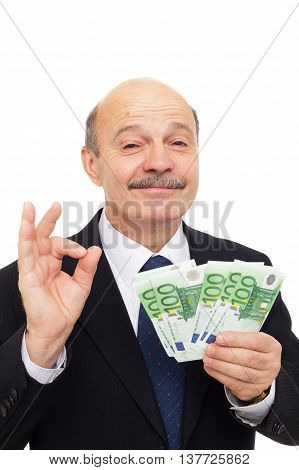 Satisfied Businessman Loves Money And Sniffing Them With Admiration