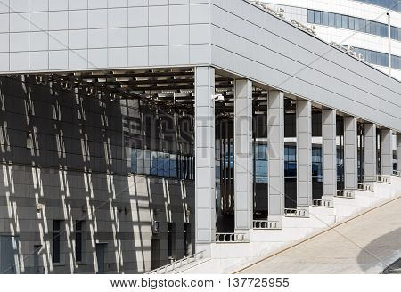 MINSK BELARUS - MAY 03 2016: Minsk-Arena - a sports and entertainment complex in the city of Minsk Belarus. Close-up of modern industrial building with a colonnade.