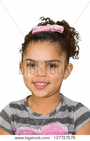 Beautiful biracial six year old little girl smiling and isolated on white background.
