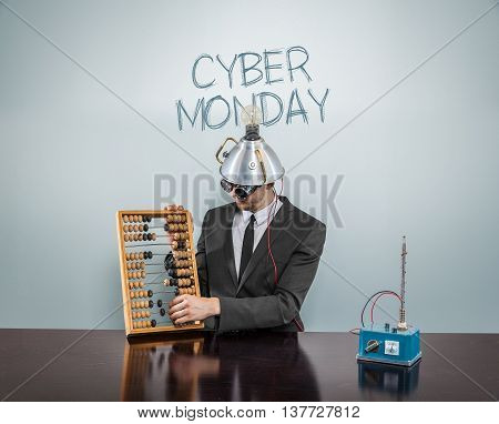 Cyber monday concept with businessman and abacus