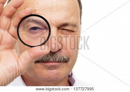 Man Is Holding A Protective Filter For The Lens And Look Through It