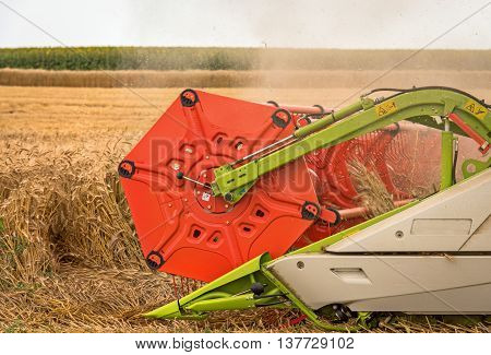 combine harvester close up, blue sky and agriculture