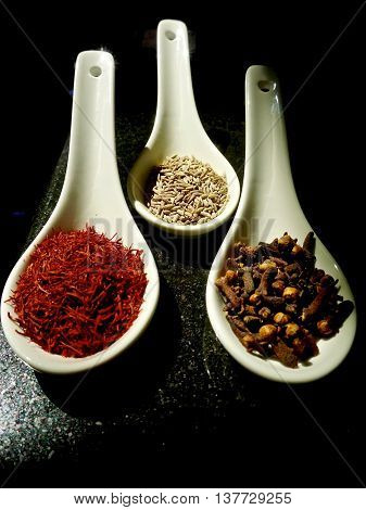 Trio of loose spices in set of spoons
