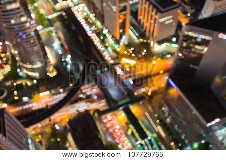 Abstract blurred lights, aerial view crossing road in city downtown night view