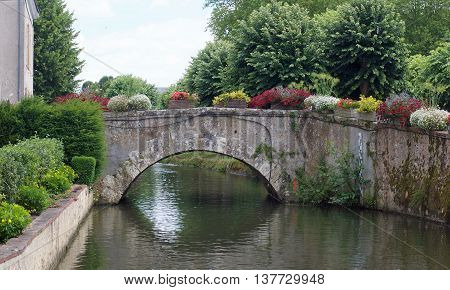urban landscape with a bridge and vegetation in Bonneval, Eure et Loire, France