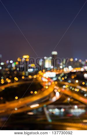 Abstract blurred lights highway intersection and city downtown background, night view