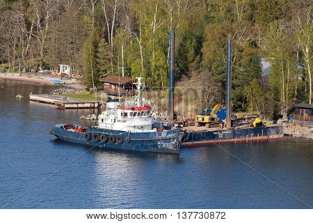 Swedish Industrial Tug Karl Alfred Moored Near Pier