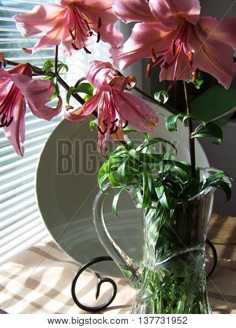 Pink lilies on the table close-up - vertical