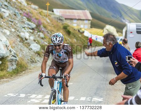 Col de la Croix de Fer France - 25 July 2015:The French cyclist Christophe Riblon of AG2R La Mondiale Team climbing to the Col de la Croix de Fer in Alps during the stage 20 of Le Tour de France 2015.