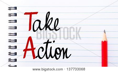 Ta Take Action Written On Notebook Page