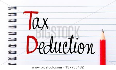 Td Tax Deduction Written On Notebook Page