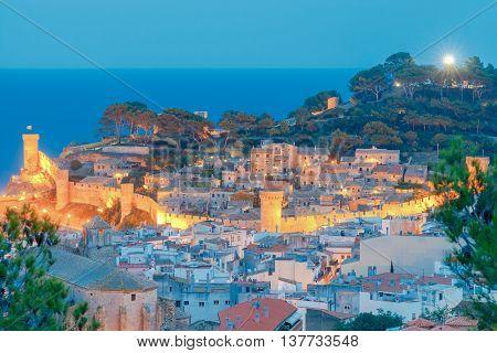 Night view of ancient fortress and Badia de Tossa bay in Tossa de Mar on Costa Brava, Catalunya, Spain.