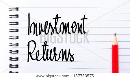Investment Returns Written On Notebook Page