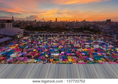 Opening wooden floor, Night weekend market roof top with beautiful sky background
