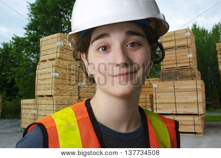 girl working at the sawmill, construction wood industry
