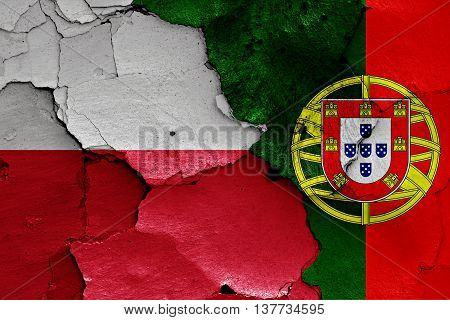 Flags Of Poland And Portugal Painted On Cracked Wall