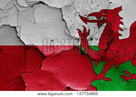 Flags Of Poland And Wales Painted On Cracked Wall