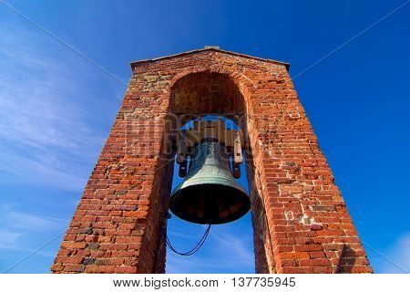 brick tower with bells ringing to tell the time