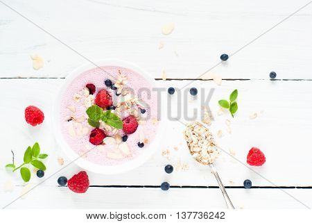 Yogurt with berries. Homemade yogurt or whipped milk shake with fresh berries. Serve with berries, almond flakes and oat flakes.