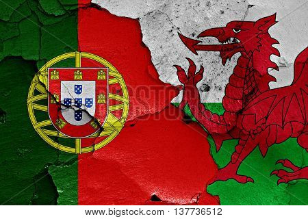Flags Of Portugal And Wales Painted On Cracked Wall