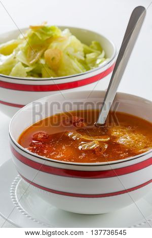 Typical Spanish chorizo soup in a bowl.