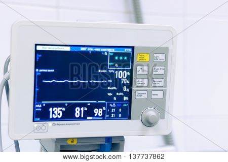 Monitor the patient's vital signs with, close up