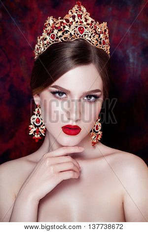 Girl wearing tiara and sparkling jewlery. Vogue style