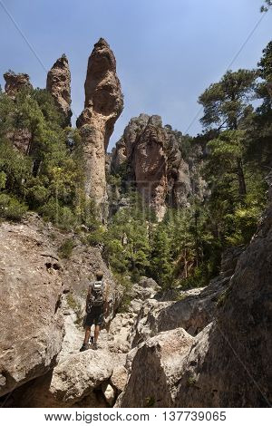Regatxol Spain-07 june 2016: A mature caucasian hiker with his backpack in the end of ravine watching the bautiful landscape on the Port of Beceit