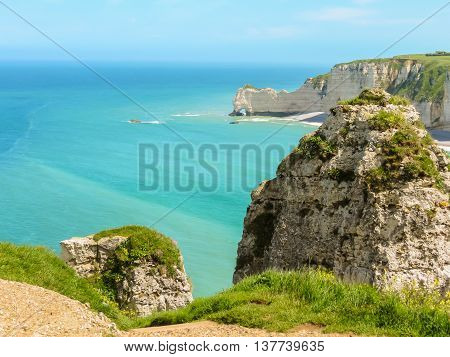 Tops of white chalk cliffs - Cote d'Albatre or Alabaster Coast is part of the French coast of the English Channel. Etretat France