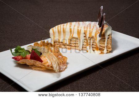Fresh honey cake served on a white plate