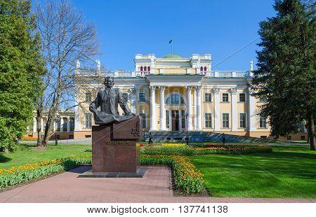 GOMEL BELARUS - APRIL 29 2016: Palace of Rumyantsev-Paskevich and monument to Count Rumyantsev in spring park Gomel Belarus