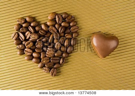 Image of two shapes of heart: made up of grained coffee and chocolate toffee