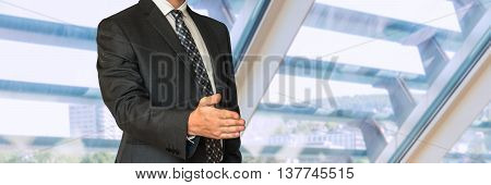 Businessman In Suit Giving Hand For Handshake
