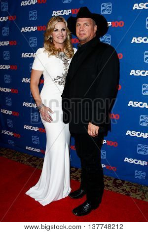 NEW YORK-NOV 17: Singer Trisha Yearwood (L) and Garth Brooks attend the ASCAP Centennial Awards at The Waldorf Astoria on November 17, 2014 in New York City.