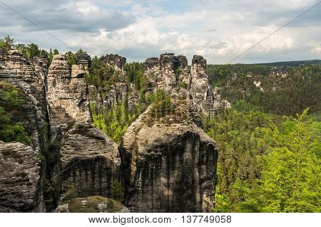 Beautiful View Of Rocks Near Bridge Bastei In Saxon Switzerland