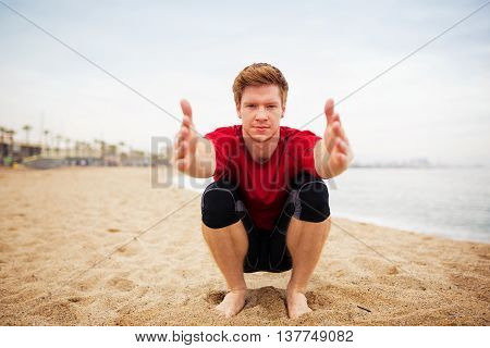 Man Pulling Hands In Front Of Him