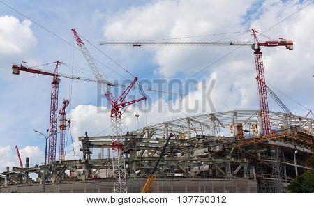 unfinished building large circular sports stadium summer
