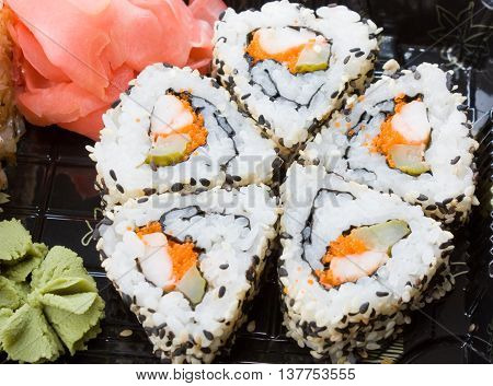 Traditional sushi and rolls on the dish.