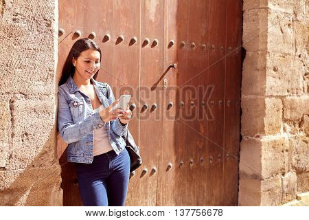 Pretty Young Girl Leaning Against Doors