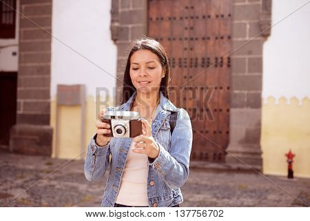 Serious Young Girl Taking A Picture