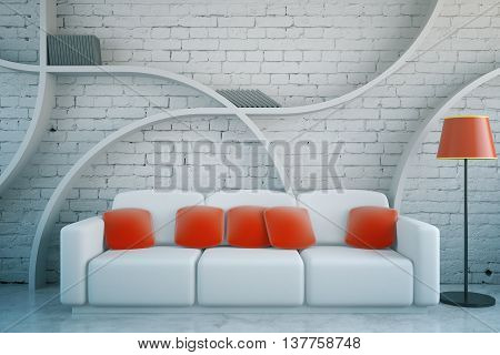 Front view of futuristic living room interior with red pillows on white couch floor lamp and abstract shelves on brick wall background. 3D Rendering